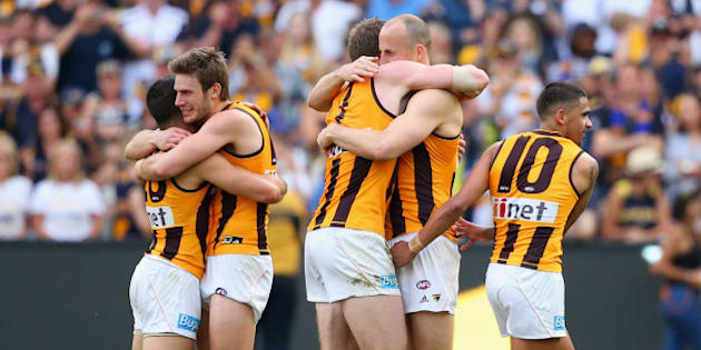 MELBOURNE, AUSTRALIA - OCTOBER 03: The Hawks celebrate winning the 2015 AFL Grand Final match between the Hawthorn Hawks and the West Coast Eagles at Melbourne Cricket Ground on October 3, 2015 in Melbourne, Australia.  (Photo by Quinn Rooney/Getty Images)