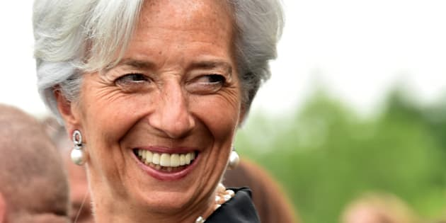 International Monetary Fund Managing Director Christine Lagarde shares a joke prior to the gala dinner in the honor of the French navy frigate L'Hermione at Mount Vernon, Virginia on June 09, 2015. A replica of L'Hermione which brought General Lafayette to America to rally rebels fighting Britain in the US war of independence, arrived in the United States again, 235 years after the original crossing.   AFP PHOTO/MLADEN ANTONOV/POOL
