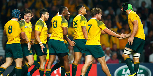 LONDON, ENGLAND - OCTOBER 03:  Bernard Foley of Australia (2R) celebrates the second try with team mates during the 2015 Rugby World Cup Pool A match between England and Australia at Twickenham Stadium on October 3, 2015 in London, United Kingdom.  (Photo by Mike Hewitt/Getty Images)