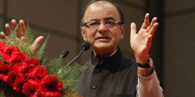 Indian Finance Minister Arun Jaitley speaks during a conference on 'Regulatory Framework for International Financial Services Centre (IFSC) in India', in Gandhinagar, India, Friday, April 10, 2015. Jaitley announced rules and regulations for foreign and domestic financial services companies who wish to set up operations at India's first IFSC. (AP Photo/Ajit Solanki)