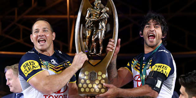 SYDNEY, AUSTRALIA - OCTOBER 04:  Matthew Scott of the Cowboys and Johnathan Thurston of the Cowboys hold aloft the premiership trophy after winning the 2015 NRL Grand Final match between the Brisbane Broncos and the North Queensland Cowboys at ANZ Stadium on October 4, 2015 in Sydney, Australia.  (Photo by Cameron Spencer/Getty Images)