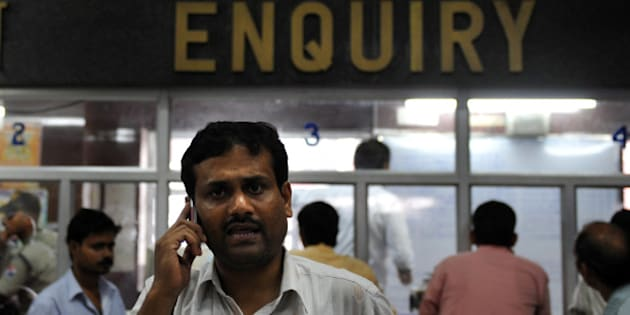A relative, looking for information on the fate of passengers following the derailment of the Delhi-bound Kalka Mail train, talks on his mobile phone near a counter in Howrah Station in Kolkata on July 10, 2011. A packed passenger train travelling at full speed derailed in northern India July 10 killing at least 35 people and leaving up to 100 injured after carriages were thrown off the tracks.  AFP PHOTO/Dibyangshu SARKAR (Photo credit should read DIBYANGSHU SARKAR/AFP/Getty Images)