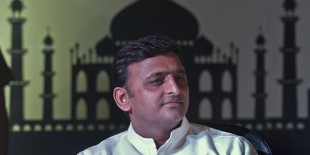 Uttar Pradesh (UP) Chief Minster Akhilesh Yadav listens during the UP Investor Conclave in New Delhi on June 12, 2014. The Uttar Pradesh government signed 20 initial agreements with corporates entailing investments worth 35,000 crore rupees (59 million dollars) during the investors conclave.  AFP PHOTO/Prakash SINGH        (Photo credit should read PRAKASH SINGH/AFP/Getty Images)