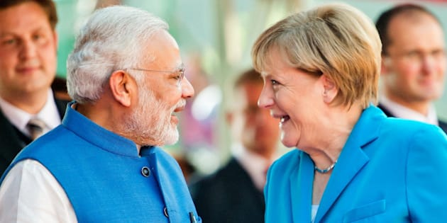 NEW DELHI, INDIA - OCTOBER 05: German Chancellor Angela Merkel and India's Prime Minister Narendra Modi during German India Government consultations on October 05, 2015 in New Delhi, India. Merkel is on a three day visit to India which will see her  boost already strong ties with the country, as Germany continues to be India's most imporant European trading partner.  (Photo by Michael Gottschalk/Photothek via Getty Images)