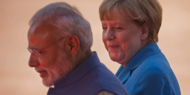 German Chancellor Angela Merkel, right, and Indian Prime Minister, Narendra Modi during the ceremonial reception at Rashtrapati Bhavan, the presidential palace, in New Delhi, India, Monday, Oct. 5, 2015. (AP Photo/Saurabh Das)