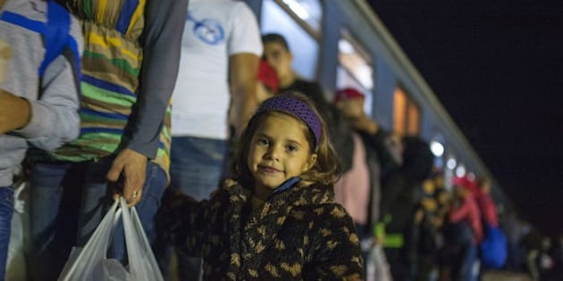 Migrants and refugees board a train, after crossing the Greek-Macedonian border, near Gevgelija on October 5, 2015. Macedonia is a key transit country in the Balkans migration route into the EU, with thousands of asylum seekers and migrants -- many of them from Syria, Afghanistan, Iraq and Somalia -- entering the country every day. AFP  PHOTO / ROBERT ATANASOVSKI        (Photo credit should read ROBERT ATANASOVSKI/AFP/Getty Images)