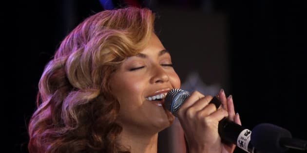 Beyoncé sings the national anthem during a news conference Thursday, Jan. 31, 2013, in New Orleans. Beyoncé is scheduled to perform during halftime of the NFL Super Bowl XLVII football game on Sunday, Feb. 3, 2013. (AP Photo/Morry Gash)