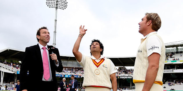 LONDON, ENGLAND - JULY 05: MCC captain Sachin Tendulkar tosses the coin alongside Rest of the World captain Shane Warne during the MCC and Rest of the World match at Lord's Cricket Ground on July 5, 2014 in London, England.  (Photo by Ben Hoskins/Getty Images)
