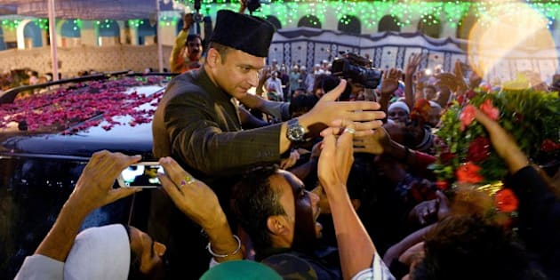 Indian Muslim leader of All India Majlis-e-Ittihad al-Muslimin and member of the Legislative Assembly of the state of Telangana Akbaruddin Owaisi (C) shakes hands with members of his community during a visit to an 'Iftar' party held to break the Ramadan fast in Bangalore on July 9, 2015. Muslim devotees globally are marking the month of Ramadan by fasting from dawn until dusk. AFP PHOTO/Manjunath KIRAN        (Photo credit should read MANJUNATH KIRAN/AFP/Getty Images)