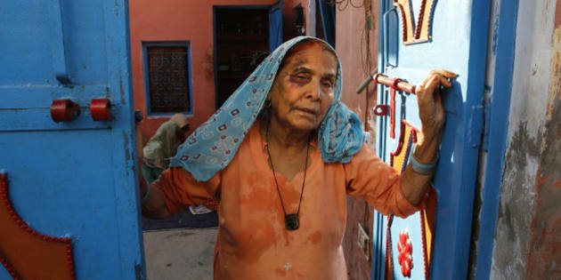 A bruised Asgari Begum, mother of 52-year-old Muslim farmer Mohammad Akhlaq, stands by the entrance of her home in Bisara, a village about 45 kilometers (25 miles) southeast of the Indian capital of New Delhi, Wednesday, Sept. 30, 2015. Indian police arrested eight people and were searching Wednesday for two more after villagers allegedly beat Akhlaq to death and severely injured his son upon hearing rumors that the family was eating beef, a taboo for many among India's majority Hindu population. Since Prime Minister Narendra Modi, a Hindu nationalist, took office last year, hard-line Hindus have been demanding that India ban beef sales, a key industry for many within India's poor, minority Muslim community. In many Indian states, the slaughtering of cows and selling of beef are either restricted or banned. (AP Photo/Manish Swarup)