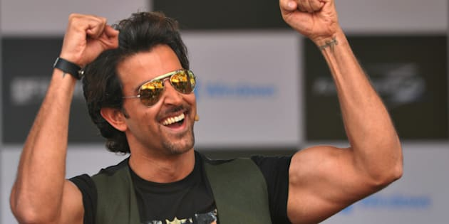 Indian Bollywood actor, Hrithik Roshan gestures as he arrives on stage to launch the Windows platform based game Krrish 3 at a college in Bangalore on October 7, 2013. The game developed by Hungama Digital Media Entertainment and Gameshastra is based on the yet to be released Bollywood movie 'Krrish 3' in which Hrithik Roshan plays superhero. AFP PHOTO/ Manjunath KIRAN        (Photo credit should read Manjunath Kiran/AFP/Getty Images)