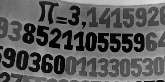 circa 1960:  A man stands in front of a blackboard illustrating the pi number.  (Photo by Paul Almasy/BIPs/Getty Images)