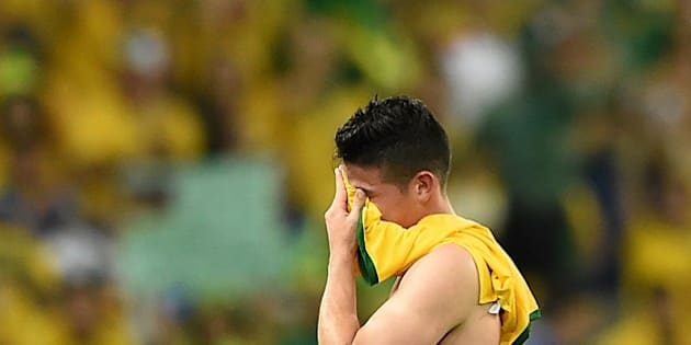 Colombia's midfielder James Rodriguez reacts as he leaves the pitch after the quarter-final football match between Brazil and Colombia at the Castelao Stadium in Fortaleza during the 2014 FIFA World Cup on July 4, 2014. Brazil won 2 to1.     AFP PHOTO / EITAN ABRAMOVICH        (Photo credit should read EITAN ABRAMOVICH/AFP/Getty Images)