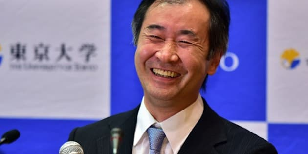 Takaaki Kajita, a professor at the University of Tokyo Institute for Cosmic Ray Research smiles at a press conference after it was announced he had won the Nobel Physics Prize at the University of Tokyo on October 6, 2015, for resolving a mystery with co-winner Arthur McDonald of Canada about neutrinos, a fundamental but enigmatic particle. The pair were honoured for work that helped determine that neutrinos have mass, the Royal Swedish Academy of Sciences said.  AFP PHOTO / Yoshikazu TSUNO        (Photo credit should read YOSHIKAZU TSUNO/AFP/Getty Images)