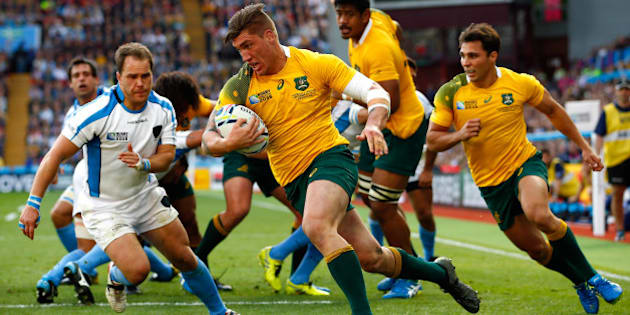 BIRMINGHAM, ENGLAND - SEPTEMBER 27:  Sean McMahon of Australia runs in to score his side's first try during the 2015 Rugby World Cup Pool A match between Australia and Uruguay at Villa Park on September 27, 2015 in Birmingham, United Kingdom.  (Photo by Dan Mullan/Getty Images)
