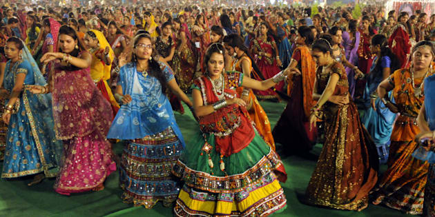 INDORE, INDIA - SEPTEMBER 25: Girls take part in Garba dance on the first day of Navratri festival near Madan Mahal garden on September 25, 2014 in Indore, India. Hindu festival of Navratri is observed twice a year, once in the beginning of summer and again at the onset of winter. Navratri means nine nights during which nine forms of Goddess/ Shakti/Devi are worshiped. (Photo by Amit K Jaiswal/Hindustan Times via Getty Images)