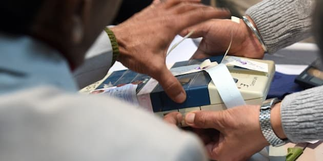 Indian election officials open a Electronic Voting Machine (EVM) at a vote counting centre in New Delhi on February 10, 2015. Counting of votes  started for Delhi state elections, with exit polls indicating former chief minister Arvind Kejriwal's anti-corruption party has comfortably beaten Prime Minister Narendra Modi's Hindu nationalists.  AFP PHOTO/ PRAKASH SINGH        (Photo credit should read PRAKASH SINGH/AFP/Getty Images)