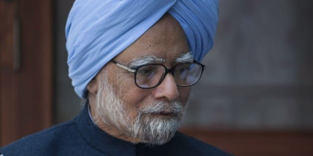 """Former Indian prime minister Manmohan Singh, sits with the newly elected office bearers of """"National Students' Union of India"""" (NSUI), who called on him at his residence in New Delhi, India, Tuesday, March 17, 2015. A special Indian court last week summoned Singh, accusing him of criminal conspiracy and breach of trust for his alleged role in a multibillion dollar scandal over the sale of coal fields. (AP Photo/Tsering Topgyal)"""