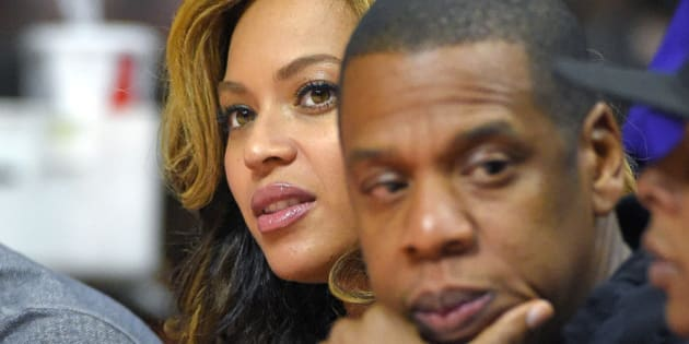 Singer Beyonce, left, and Jay-Z attend the first half of an NBA basketball game between the Los Angeles Clippers and the Brooklyn Nets, Thursday, Jan. 22, 2015, in Los Angeles. (AP Photo/Mark J. Terrill)