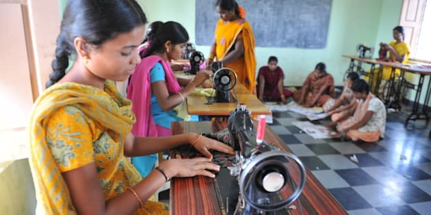 Indian rural women use sewing machines at the Mother Teresa Rural Development Society centre at Narketpally of Nalgonda District, some 85 kilomeres from Hyderabad on September 9, 2011. The rural women of Nalgonda district formed a Self Help Group (SHG), supported by Mother Teresa Rural Development Society (MTRDS), a non-profit development organisation run by a group of voluntary social workers serving the marginalised farmers, rural women and weaker sections of the community towards their empowerment and sustainable development. AFP PHOTO / Noah SEELAM        (Photo credit should read NOAH SEELAM/AFP/Getty Images)