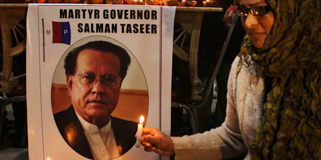 LAHORE, PUNJAB, PAKISTAN - 2015/01/05: A woman holds a candle during the commemoration of the 4th death anniversary of Governor Salman Taseere. Salman Taseer, was shot and killed by his own guard, Mumtaz Qadri, in broad day light in December 2011 in capital city Islamabad. (Photo by Rana Sajid Hussain/Pacific Press/LightRocket via Getty Images)