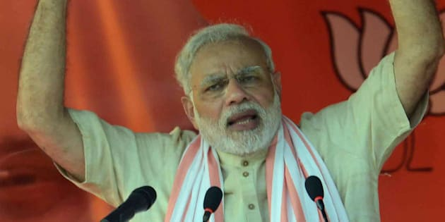 Indian Prime Minister Narendra Modi speaks during an election rally in Banka district of the eastern Indian state of Bihar, Friday, Oct. 2, 2015. The five-phased polls in the state will begin on Oct. 12. (AP Photo/Aftab Alam Siddiqui)