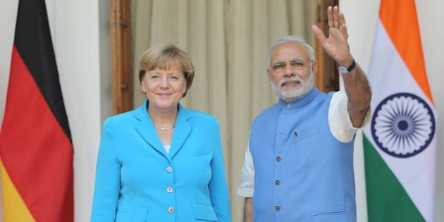 NEW DELHI, INDIA - OCTOBER 5: Indian Prime Minister Narendra Modi (R) and German Chancellor Angela Merkel (L) pose during a photo call as they arrive for meetings at Hyderabad House in New Delhi, India on October 5, 2015. Angela Merkel has begun a mission to clear the path for German companies keen to do business in India, as Prime Minister Narendra Modi looks to the European powerhouse to help revive its economy. (Photo by Santosh Singh     /Anadolu Agency/Getty Images)