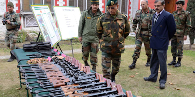 SRINAGAR, KASHMIR, INDIA - NOVEMBER 24: Lieutenant General Subrata Saha of Indian Army inspects seized arms and ammunitions  , recovered by them in Kupwara near the ceasefire line or Line of Control (LoC) that divides Kashmir between India and Pakistan, at Chinar corps headquarter on November 24, 2014, in Srinagar, the summer capital of Indian administered Kashmir, India. The Indian army claimed to have recovered arms and ammunition from a suspected militant hideout on Sunday in the forest area of Kupwara district near LoC of poll-bound Indian administered Kashmir. Amid tight security, more than five million people will cast their votes in the coming assembly elections in the strife torn Jammu and Kashmir, even as most pro-independence groups have asked people to boycott the five phased polls starting on November 25 and ending on December 20. The votes will be counted on December 23. (Photo by Yawar Nazir/Getty Images