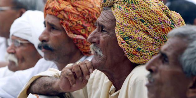 Protesting Indian Gujjar community members listen to a leader's speech during a demonstration in New Delhi on June 5, 2008.  The Gujjar ethnic community wants the government to classify them as 'Scheduled Tribes' entitled to government jobs and education benefits. Since Gujjars started protesting in the western state of Rajsthan a few weeks ago, 37 people have lost their lives in clashes with police.   AFP PHOTO/RAVEENDRAN (Photo credit should read RAVEENDRAN/AFP/Getty Images)