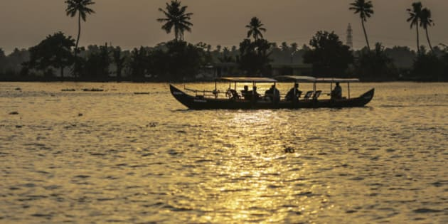 Tourists travel in a boat along the backwaters at sunset in Alappuzha, Kerala, India, on Saturday, May 30, 2015. Prime Minister Narendra Modi is counting on a revival in credit to accelerate growth in Asia's third-largest economy after the RBI cut its benchmark interest rate three times this year. Photographer: Dhiraj Singh/Bloomberg via Getty Images