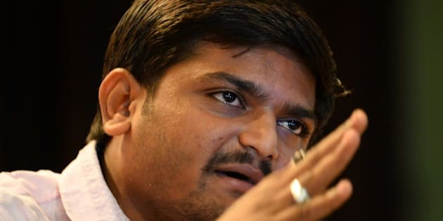 Indian convenor of the 'Patidar Anamat Andolan Samiti' movement Hardik Patel addresses a press conference in New Delhi on September 30, 2015. Patel led recent protests in the state of Gujarat demanding preferential treatment regarding jobs and university places for the Patidar caste. AFP PHOTO / SAJJAD HUSSAIN        (Photo credit should read SAJJAD HUSSAIN/AFP/Getty Images)