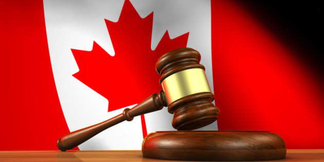 Law and justice of Canada concept with a 3d rendering of a gavel on a wooden desktop and the Canadian flag on background.