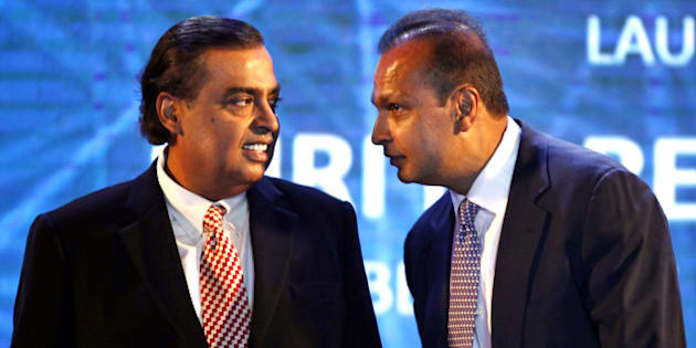 NEW DELHI, INDIA - JULY 1: Tycoon brothers Reliance Chairman Mukesh Ambani and Reliance ADA Group Chairman Anil Ambani during the launch of Digital India Week by Prime Minister Narendra Modi at IGI Stadium on July 1, 2015 in New Delhi, India. The Digital India Week which is part of the $18 billion campaign to provide fast internet connections for all and is aimed at popularising Prime Minister Narendra Modi's campaign promise to connect 250,000 villages in India by 2019. (Photo by Ajay Aggarwal/Hindustan Times via Getty Images)