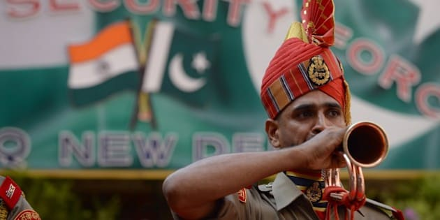 An Indian Border Security Force (BSF) ceremonial guard blows a bugle during a reception for Pakistan Rangers Director General (Punjab) Major General Umar Farooq Burki prior to a meeting at the BSF headquarters in New Delhi on September 10, 2015. Members of the Pakistan Rangers are in India for talks with the Border Security Force, scheduled to take place between September 10-13. AFP PHOTO/PRAKASH SINGH        (Photo credit should read PRAKASH SINGH/AFP/Getty Images)