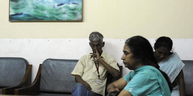 TO GO WITH HEALTH-INDIA-SOCIETY BY YASMEEN MOHIUDDIN  Members of Sanjali relax at the Sanjali daycare rehabilitation centre for mental illnesses in New Delhi on May 28, 2009. Most of the patients at the Sanjali rehabilitation centre in New Delhi cannot explain why they are there or what their lives were like before chronic mental illness struck. But they are among the lucky few in India to receive regular treatment in a country where discussing mental health carries a huge stigma and mental hospitals are often strict and frightening institutions. Experts say around 20 million Indians are afflicted with serious mental disorders, and most are hidden from public view by their families. Treatment normally ranges from temple visits to sessions with informal faith healers or more extreme 'cures' involving everything from witchcraft to iron chains.  AFP PHOTO/ Manpreet ROMANA (Photo credit should read MANPREET ROMANA/AFP/Getty Images)