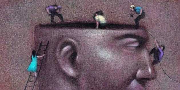 People Looking in Man's Head