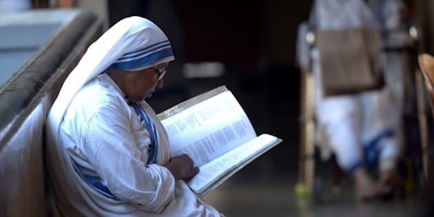 Indian nuns from the Catholic Order of the Missionaries of Charity take part in a mass to commemorate the 105th birthday of Mother Teresa at the Indian Missionaries of Charity house in Kolkata on August 26, 2015. Mother Teresa, a Nobel peace prize winner and Roman Catholic saint-in-waiting, was born on August 26, 1910 to Albanian parents in what is now Skopje in Macedonia. AFP PHOTO/Dibyangshu SARKAR        (Photo credit should read DIBYANGSHU SARKAR/AFP/Getty Images)