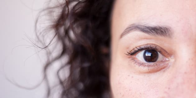 Close up of a woman's brown eye, strong selective focus