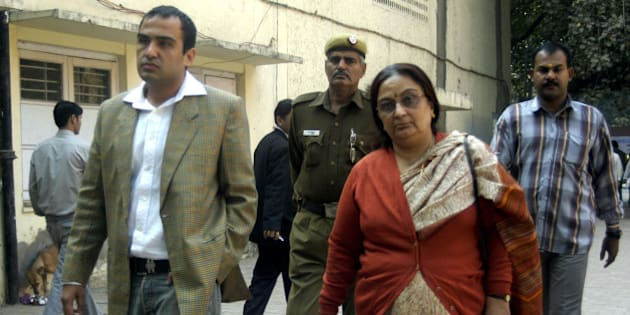 INDIA - NOVEMBER 27:  Nitin Katara and Neelam Katara, brother and mother of Nitish Katara, in Patiala House court, New Delhi, premise where Bharti Yadav, sister of accused Vikas and Vishal Yadav, was produced as a witness of Nitish Katara murder case. November 27, 2006.  (Photo by Imtiyaz Khan/The India Today Group/Getty Images)