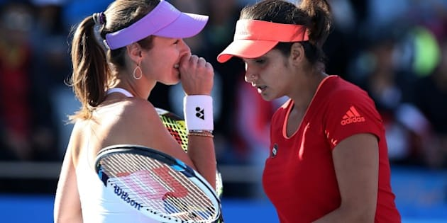 BEIJING, CHINA - OCTOBER 08:  (CHINA OUT) Sania Mirza of India (R) and Martina Hingis of Switzerland in action during their women's doubles quarter-final match against Julia Goerges of Germany and Karolina Pliskova of the Czech Republic at the China Open tennis tournament on October 8, 2015 in Beijing, China.  (Photo by ChinaFotoPress/ChinaFotoPress via Getty Images)