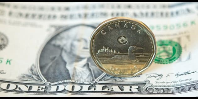TORONTO, ONTARIO, CANADA - 2015/03/11: The Canadian dollar or loonie is under pressure amid weak oil prices and a strengthening U.S. currency.