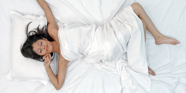 Young woman waking up from her sleep