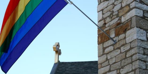 Rainbow flag on a church.
