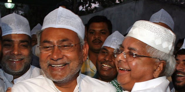 Indian Railway Minister Laloo Prasad Yadav, right, hugs Chief Minister of Bihar state Nitish Kumar during an Iftar, or breaking of fast during the holy month of Ramadan, in Patna, India, Friday, Oct. 20, 2006. (AP Photo/Prashant Ravi)