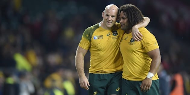 Australia's hooker Stephen Moore (L) celebrates with Australia's hooker Tatafu Polota-Nau (R)  after winning a Pool A match of the 2015 Rugby World Cup between Wales and Australia at Twickenham Stadium, southwest London, on October 10, 2015. AFP PHOTO / MARTIN BUREAU RESTRICTED TO EDITORIAL USE, NO USE IN LIVE MATCH TRACKING SERVICES, TO BE USED AS NON-SEQUENTIAL STILLS        (Photo credit should read MARTIN BUREAU/AFP/Getty Images)