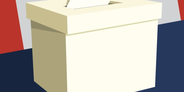 Hand inserting paper into ballot box with Canadian flag in background.
