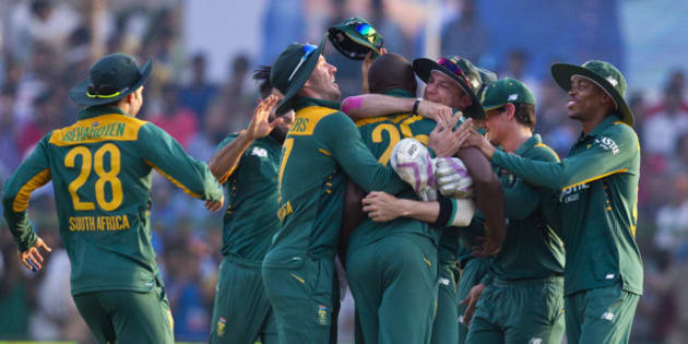 South African cricketers surround Kagiso Rabada, center, who took crucial wickets of India to swing the match towards South Africa in the last few overs during the first one day international cricket match between them in Kanpur, India, Sunday, Oct. 11, 2015. South Africa won by 5 runs. (AP Photo/Saurabh Das)