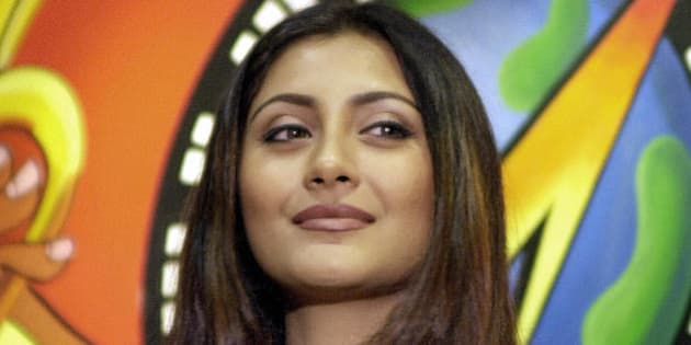 Bollywood actress Rimi Sen poses during a music launch of the film 'Hungama' a comedy thriller in Bombay, 28 May 2003. Sen plays the lead role along with Akshay Khanna and Aftab Shivdasani in the film which is scheduled for release by the end of June 2003.    AFP PHOTO / Sebastian D'SOUZA  (Photo credit should read SEBASTIAN D'SOUZA/AFP/Getty Images)