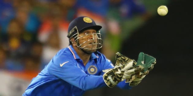 MELBOURNE, AUSTRALIA - FEBRUARY 22:  MS Dhoni of India takes a catch which was ruled not out during the 2015 ICC Cricket World Cup match between South Africa and India at Melbourne Cricket Ground on February 22, 2015 in Melbourne, Australia.  (Photo by Scott Barbour/Getty Images)