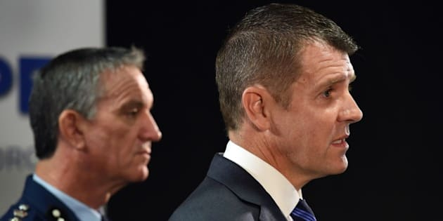 New South Wales state Premier Mike Baird (R) and police commissioner Andrew Scipione (L) speak to the media in Sydney on October 3, 2015, the day after an attack in Sydney in which a 15-year-old gunman shot dead a civilian police employee. Australian Prime Minister Malcolm Turnbull said on October 3 that the attack in Sydney appeared to have been an act of terrorism.  AFP PHOTO/William WEST        (Photo credit should read WILLIAM WEST/AFP/Getty Images)